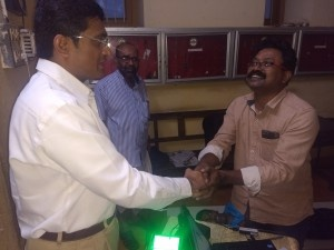 District Collector's token of appreciation for the work done by Mr AD Jayan on Adhar services